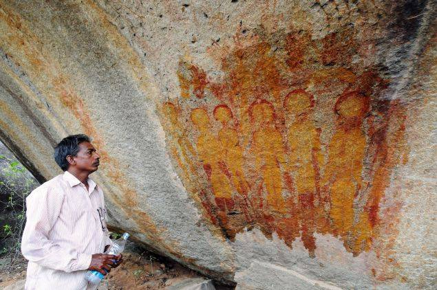 One of the ancient rock paintings carved on caves at Charama in Chhattisgarh's Kanker district. (TOI photo by Amit Bhardwaj)
